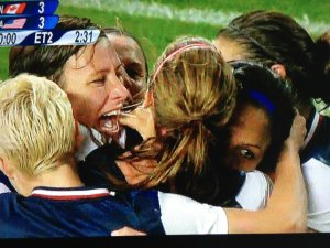 The USWNT celebrate their semifinal win over Canada in the 2012 Summer Olympics.